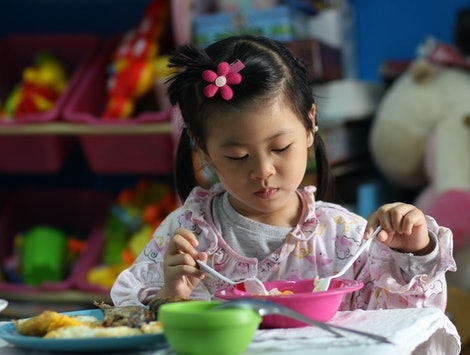 kid eating healthy food at home by yourself.family concept