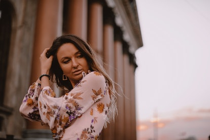 Lovely Woman with Beautiful Eyes, Big Lips and Nude Makeup. Hand on the Head. Brown Ombre Shatush Ha...