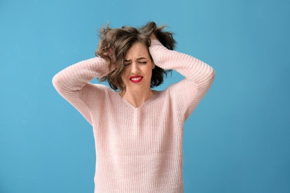 Portrait of beautiful stressed woman on color background