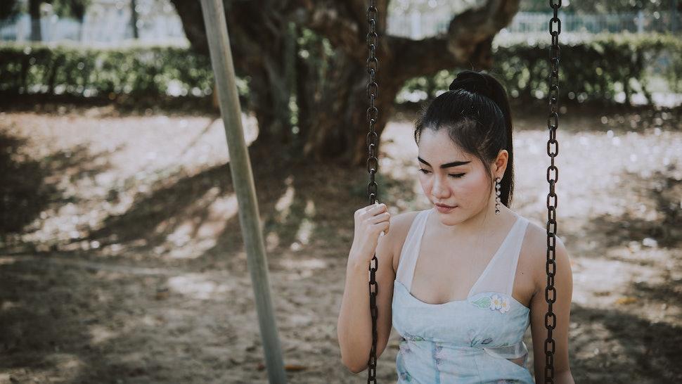 Portrait of sad asian woman cry in the park,Thailand people heartbreak concept