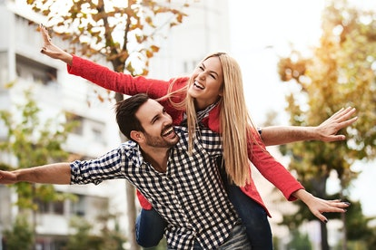 Young happy couple is enjoying city.