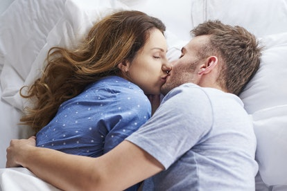 Top view of kissing couple