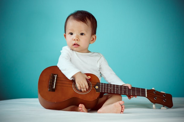 Asian child playing ukulele, Baby healthy and preschool concept