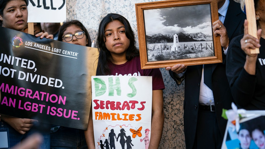 A participant holds a placard that says DHS (Department of Homeland Security) Separates Families during a symbolic funeral procession in honour of migrants who died attempting to cross the border into the US or while in the custody of Customs and Border Protection. Organizers called the event Homeland Security Kills Rally.