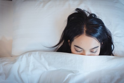Soon to wake up for sleeping attractive asian young woman.