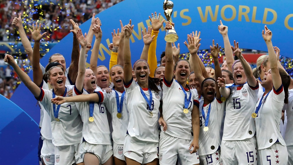 United States' team celebrates with trophy after winning the Women's World Cup final soccer match between US and The Netherlands at the Stade de Lyon in Decines, outside Lyon, France