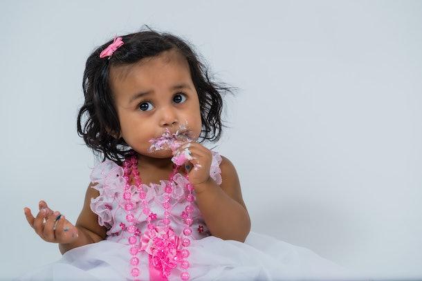 toddler cake smash, closeup portrait on white background