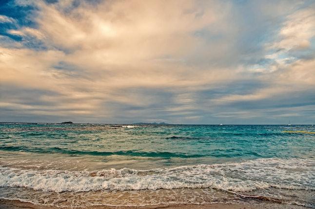 St. Maarten island beach. Caribbean beach. Caribbean sea. Blue water sea. Beautiful caribbean beach. Caribbean island blue water with blue sky