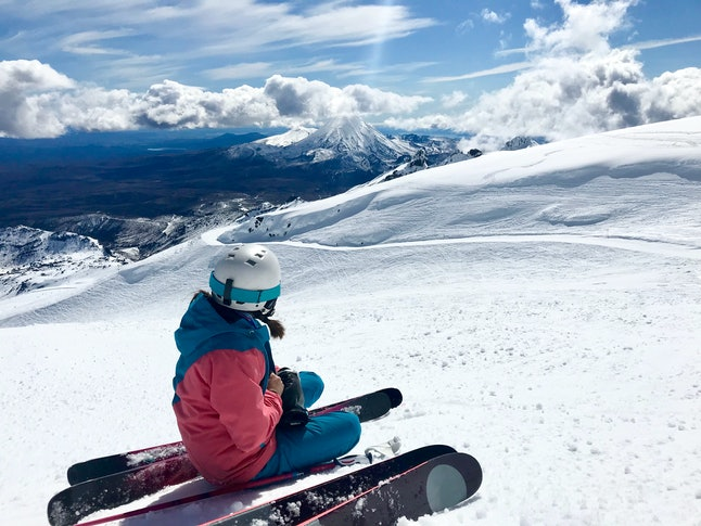 Female Skier Looks Out at Beautiful Panorama of Mt Ngauruhoe from Mt Ruapehu, New Zealand
