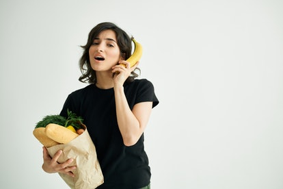 woman with a banana package with food