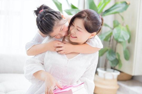 Daughter give mom a hug and mom smile happily