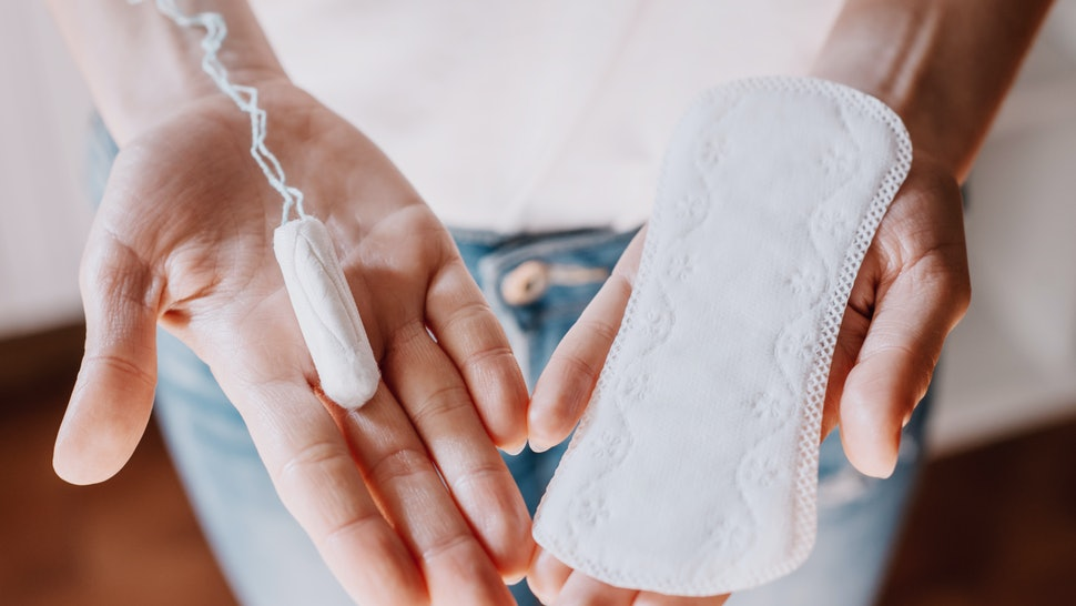 woman holding menstrual pad and tampon, life style. women's health, hygenic