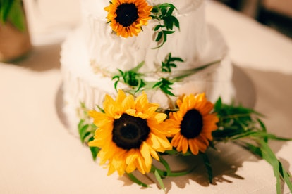 Wedding cake decorated with flowers of sunflower.