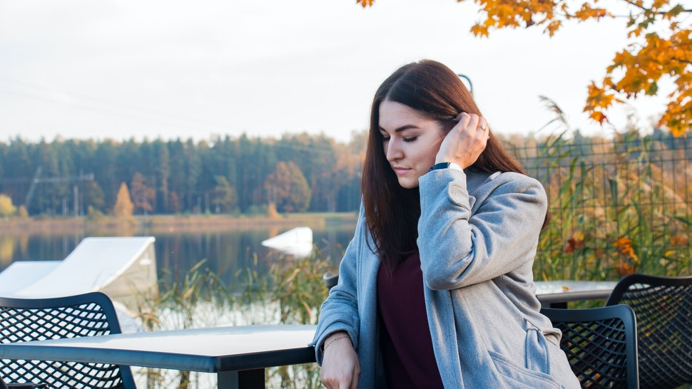 girl alone resting by the river in autumn on an autumn background