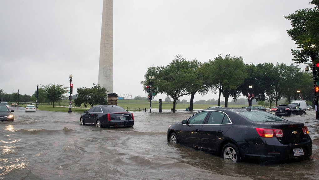 Heavy rainfall flooded the intersection of 15th Street and Constitution Ave., NW stalling cars in the street, in Washington near the Washington Monument