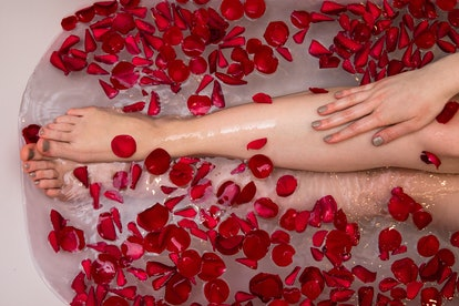 Valentines day bath with rose petails, woman in home spa, romantic luxury self care