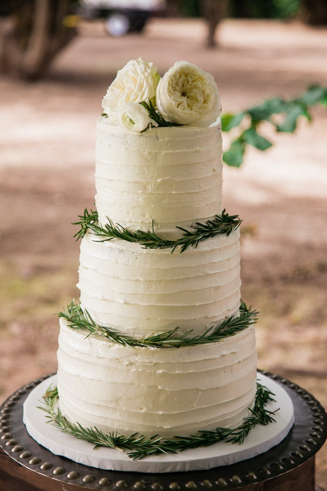 elegant and simple wedding cake with flowers on top