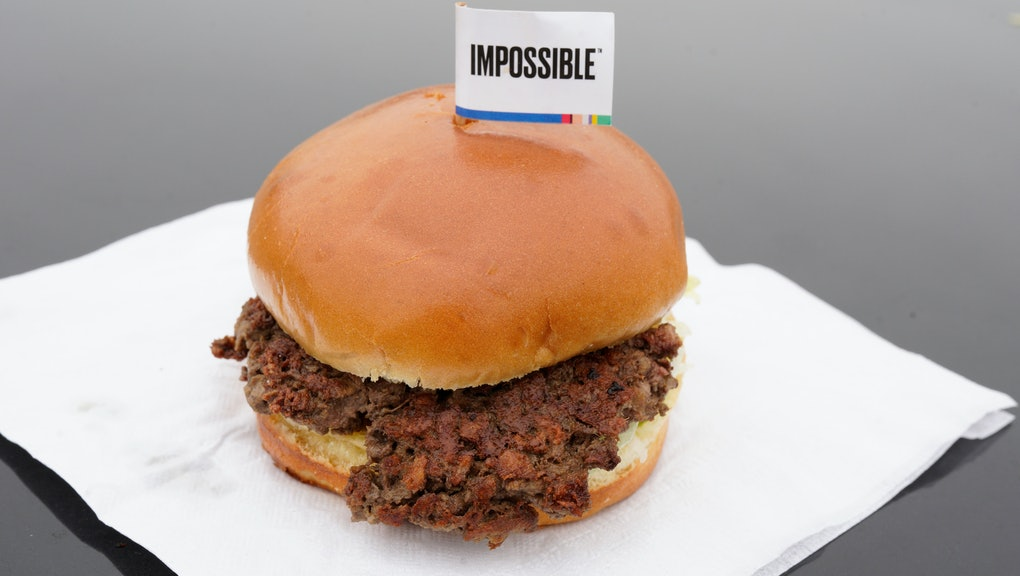 """The Impossible Burger, a plant-based burger containing wheat protein, coconut oil and potato protein among it's ingredients, is seen . The ingredients of the Impossible Burger are clearly printed on the menu at Stella's Bar & Grill in Bellevue, Neb., where meat and non-meat burgers are served. More than four months after Missouri became the first U.S. state to regulate the term """"meat"""" on product labels, Nebraska's powerful farm groups are pushing for similar protection from veggie burgers, tofu dogs and other items that look and taste like meat"""