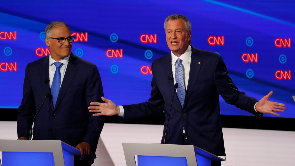 Washington Gov. Jay Inslee listens as New York City Mayor Bill de Blasio speaks during the second of two Democratic presidential primary debates hosted by CNN, in the Fox Theatre in Detroit