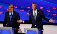 Washington Gov. Jay Inslee listens as New York City Mayor Bill de Blasio speaks during the second of...
