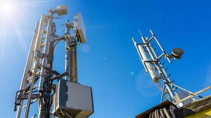 5G smart mobile telephone radio network antenna base station on the telecommunication mast radiating...