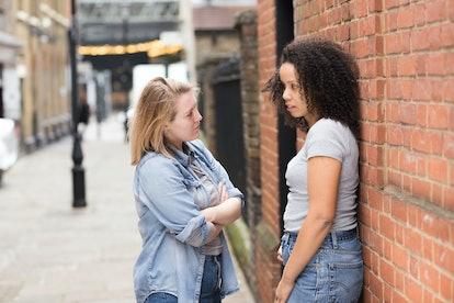 lesbian couple talking in the street