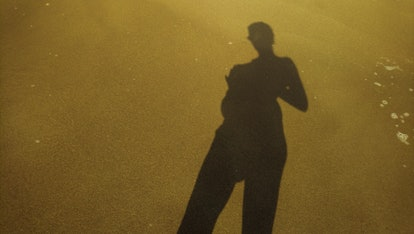 Woman shadow on a twilight background