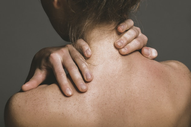 Woman massaging her neck. Suffering for painfull muscle backache.
