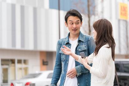 japanese couple talking on the street