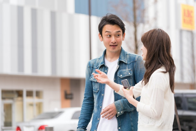 japanese couple talking on the street