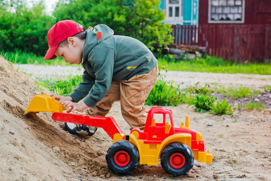 child playing in the sand excavator