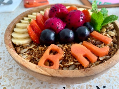 Acai smoothie bowl with bali written in fruit. Indonesian vacation food.