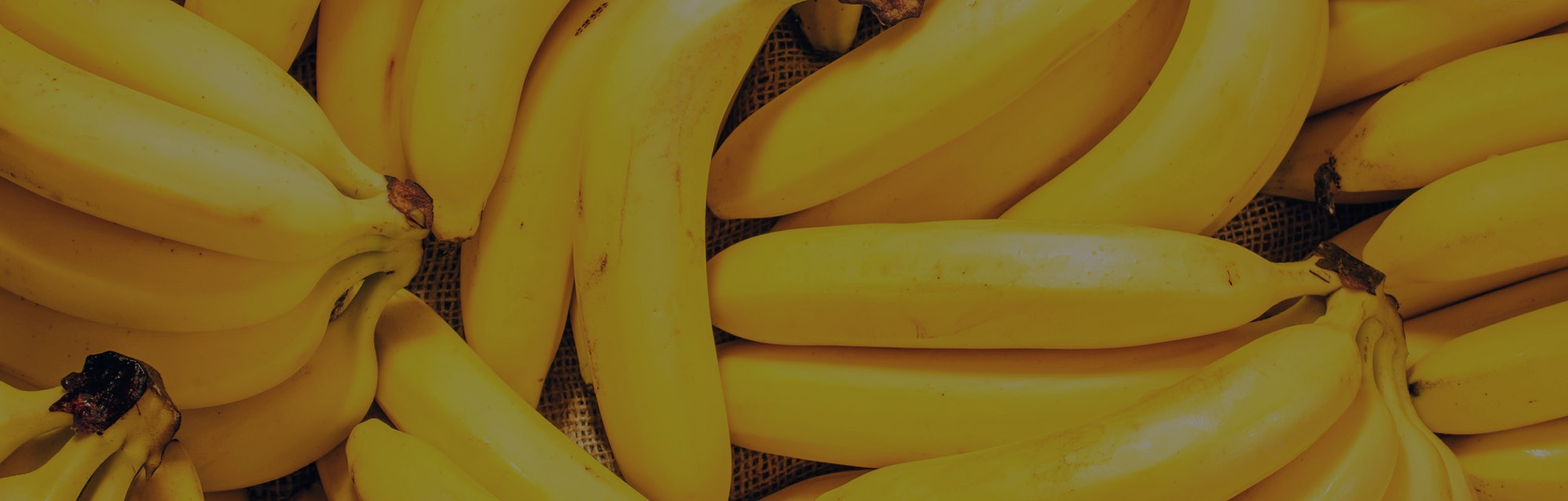 Bananas in a pile. Bananas can help acid reflux