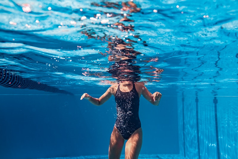 Underwater shot of a young woman swimming in the pool