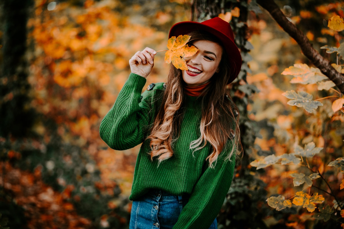 Outdoor autumn portrait of beautiful girl /model /fashion blogger/travel blogger smiling with long h...