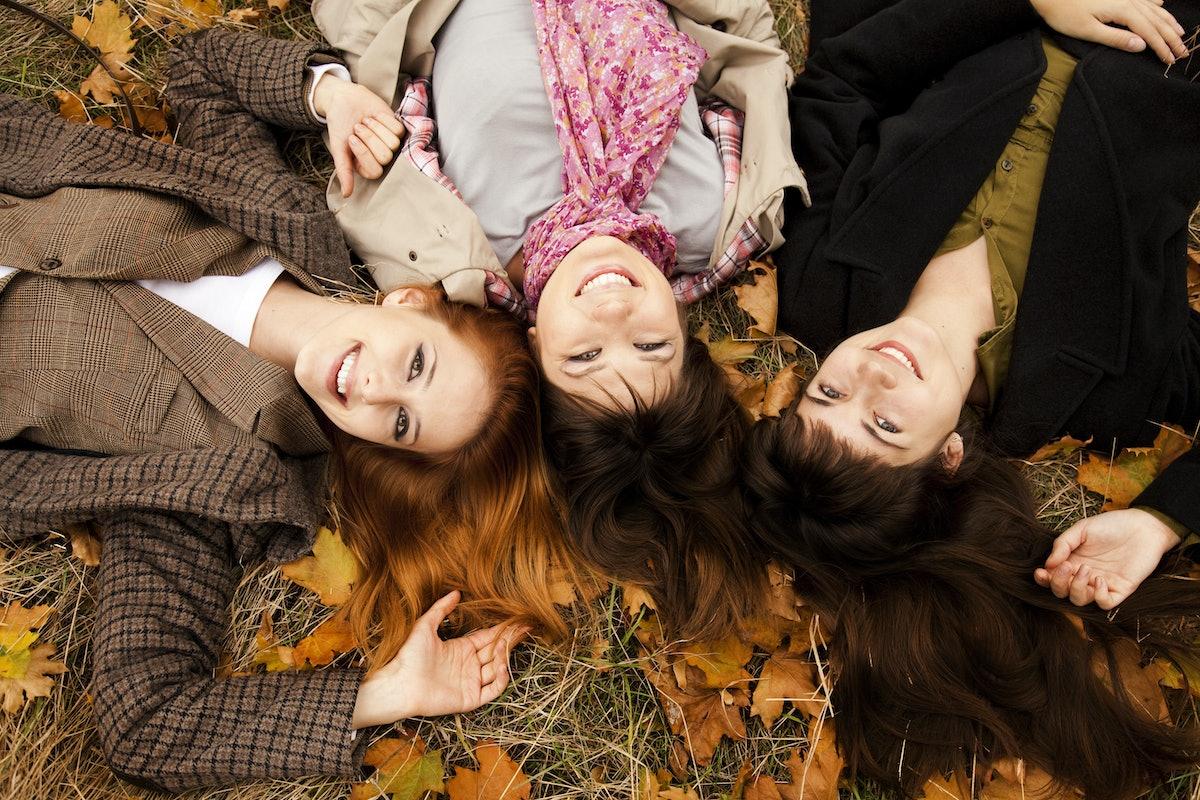 Three girls in the autumn park. Outdoor shot.