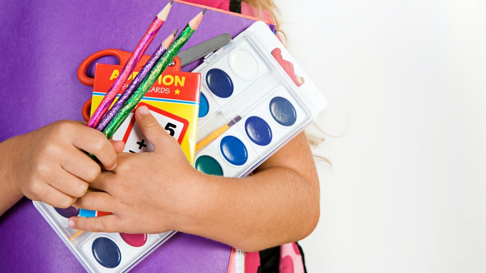 Education: Girl Holds Armful Of School Supplies