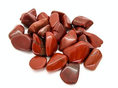 Red Jasper polished tumblestones isolated on a white background