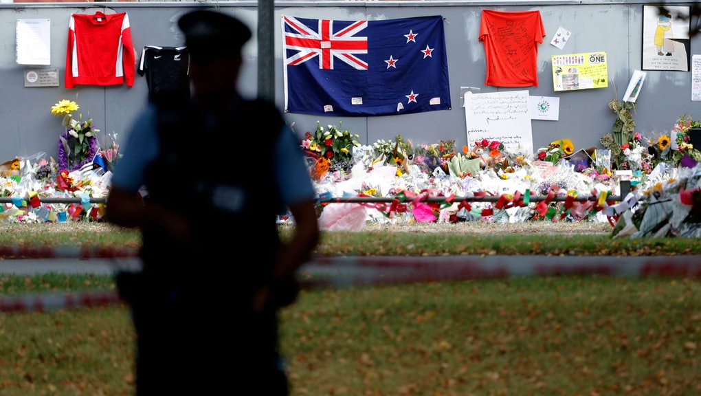 A policeman stands guard near the Al Noor mosque during Friday prayers at Hagley Park in Christchurch, New Zealand, . People across New Zealand observed the Muslim call to prayer Friday as the nation reflected on the moment one week ago when 50 people were slaughtered at two mosques