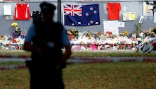 A policeman stands guard near the Al Noor mosque during Friday prayers at Hagley Park in Christchurc...