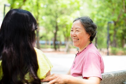 happy senior mother talking with daughter