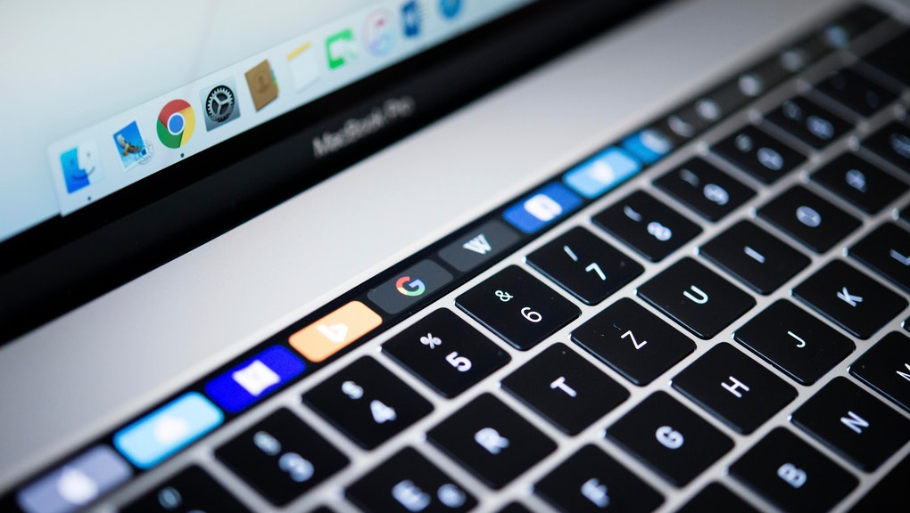 Backlit keyboard and Touch Bar showing websites, laptop, Apple MacBook Pro, close-up