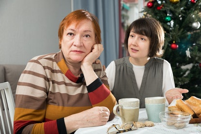 Quarrel of mother and daughter at the Christmas table