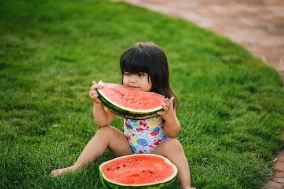 girl eats watermelon, summer season watermelons