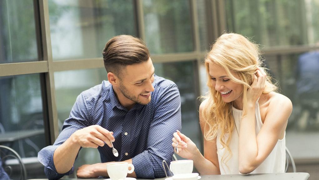 Beautiful couple having coffee on a date