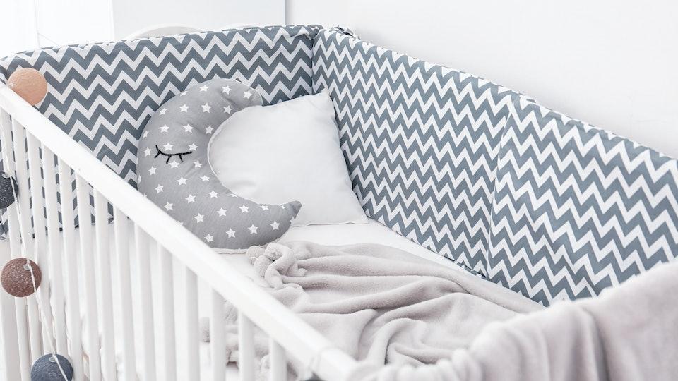 Comfortable crib in baby room. Idea for interior design