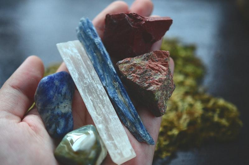 Assortment of healing crystals, like selenite, blue kyanite, red jasper, unakite, and sodalite! Macro photography of high energy, healing stones. Reiki energy healing talisman.