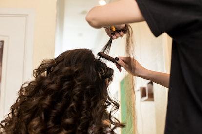 Hairdresser Curls Hair