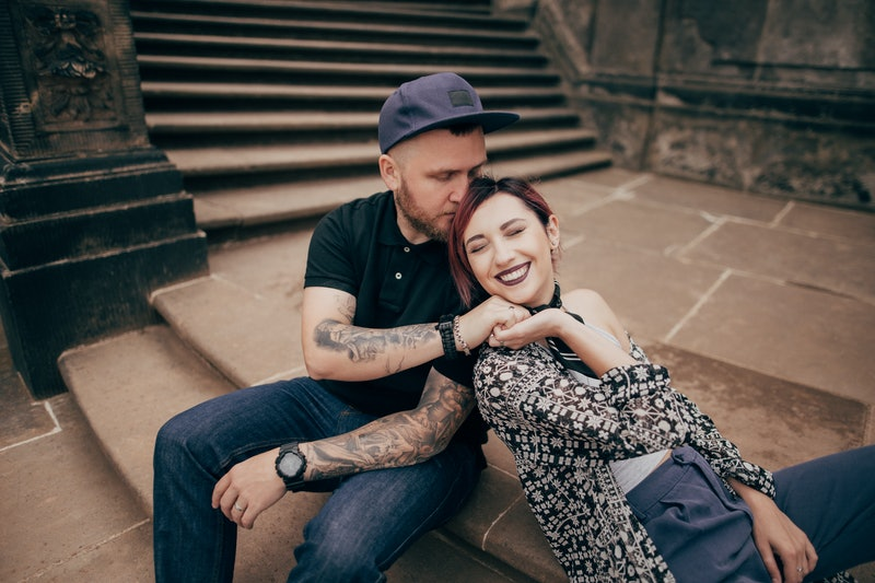 beautiful happy young couple in love sitting on stairs in Dresden