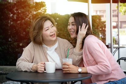 Mother with her daughter talking, hugging and looking each other laughing, happy family and people concept.